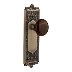 Nostalgic - Nostalgic Single Dummy-Egg and Dart Plate-Brown Porcelain Knob-Antique Brass - With its distinctive repeating border detail, as well as floral crown and foot, the Egg & Dart Plate in antique brass resonates grand style and is the ideal choice for larger doors. Adding our rich, Brown Porcelain knob only serves to compliment the warm, earthen hues in your home. All Nostalgic Warehouse knobs are mounted on a solid (not plated) forged brass base for durability and beauty.