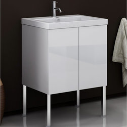 Iotti - Vanity Cabinet with Self Rimming Sink and 2 Doors - This vanity set includes a vanity cabinet with a white ceramic sink. The vanity is 23.2 inches wide. The vanity cabinet is made from waterproof panels and are produced using a environmentally friendly process These panels give you the utmost protection against dampness. Chrome legs to be purchased seperately. Made in Italy. High end ceramic sink made in Italy. Faucet not included. The engineered wood vanity is made with waterproof panels. Single vanity features 2 doors. Top of the vanity comes in a white finish.
