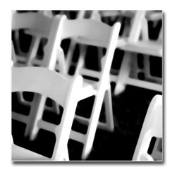 Wedding Chairs White - Print, 10x10 - This is a favorite black and white of mine. I was in Africa on a story and under a tent there were preparations for wedding ceremony. Just clean white wooden chairs, but all those angles help the imagery.