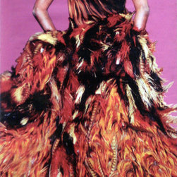 Yves Saint Laurent Feather Dress Street Banner Wall Art - From the Legion of Honor Museum, an authentic, limited edition street banner to display in your home as spectacular wall art. Yves Saint Laurent often gave leading roles to feathers, animal prints, pelts and flowers in his Haute Couture designs. His Feather Dress is a chiffon dress with a tiger print and a coat with a firework display of ostrich, rooster and pheasant feathers in gold, yellow, red and brown. Saint Laurent designed a world famous array of outfits ranging from the simplest of little black dresses to very exotic evening gowns. Feather Dress is most definitely the latter, and the banner promoting this de Young exhibition of 130 YSL ensembles features the dress exquisitely.