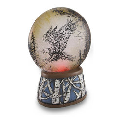 Zeckos - American Eagle Light-Up Color Changing Led Water Globe - This disc-style water globe adds a wonderful accent to shelves, bookcases, or mantels and features a color changing LED light in the base that makes the glittery snow really sparkle The disc style globe measures 4 1/2 inches (11 cm) in diameter and contains a sepia toned image of an eagle preparing to land in a tree top high above the forest floor. while the resin base depicts white birch tree trunks, and has foam pieces on the bottom to help protect delicate surfaces from scratches. The light runs on 3 AAA batteries (included), and is controlled by an on/off switch on the bottom of the base. This piece measures 6 3/4 inches tall (17 cm), 4 3/4 inches long (12 cm), and 2 3/4 inches wide (7 cm). It makes a great gift for wildlife enthusiasts, and complements outdoorsy decor.