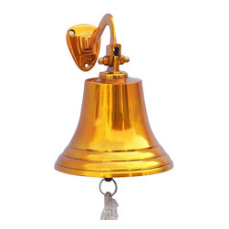 """Handcrafted Model Ships - Solid Brass Titanic Ship's Bell 9"""" - Titanic Bell - Elegantly designed and gleaming with a lustrous shine, this fabulous Brass Titanic Ship's Bell 9"""" is equally stunning indoors or out. In addition to being fully functional, this ships bell is a great addition to any nautical decor themed room. Make a nautical wall decor statement and enjoy this wonderfully decorative style and distinct, warm """"strike through"""" nautical tone with each and every resounding ring. Note: Each ships bell's length is measured from the highest point of its hanger to the lower lip of the bell, while the width is the diameter of the flared bell opening. Dimensions: 5.5"""" Long x 5.5"""" Wide x 9"""" High"""