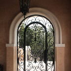 Iron Door Gate with transom - Custom iron gate door and ceiling iron sconce by San Marcos Iron Doors.
