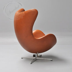 Arne Jacobsen Egg Chair by Fritz Hansen - The every stylish Egg Chair was designed by Arne Jacobsen in 1958 and is produced by Fritz Hansen in Denmark. Arne Jacobsen designed the Egg Chair for the lobby and reception areas in the Royal Hotel, in Copenhagen. The commission to design every element of the hotel building as well as the furniture was Arne Jacobsen's grand opportunity to put his theories of integrated design and architecture into practice.  Upholstered in Cameo Nevada Cognac Leather from http://www.stardust.com/jacobsenegg.html