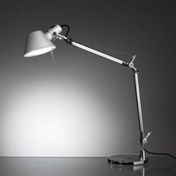 """Artemide - Tolomeo mini table lamp - Catalog featured - Product Description:  The Tolomeo mini table lamp from Artemide has been designed by Michele De Lucchi and Giancarlo Fassina. This table mounted luminaire is wonderful for adjustable direct task incandescent lighting. The Tolomeo mini comes equipped with fully adjustable articulated arm body structure in extruded brilliant, natural anodized aluminum. The joints, tension control knobs, and mountings are in polished die-cast aluminum. The diffuser is made of stamped, anodized matte aluminum, which is rotatable 360 degrees. The Tolomeo mini table lamp is a contemporary and practical way to illuminate small spaces. UL listed.   Item is in stock and ready for immediate shipment!   Details:                                Manufacturer:               Artemide                                  Designer:               Michele De Lucchi and Giancarlo Fassina                                  Made in:              Italy                                  Dimensions:                             Height: Max 40.5"""" (103cm) X Width: Max 26.75"""" (68cm)                                                Light bulb:                             1 X 100W incandescent                                                 Material               aluminum, steel,"""