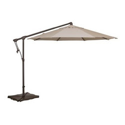 "Treasure Garden 10 ft. Cantilever Octagon Offset Patio Umbrella - Save yourself from sweltering sunshine with the Treasure Garden Cantilever 10-ft. Octagon Tilt and Lock Offset Umbrella. A popular choice for covering conversation seating or large dining sets this cantilever patio umbrella casts a generous 79 square feet of shade. The offset pole is made of aluminum and covered in a powder-coated finish for protection. The crank-style lift and locking tilt mechanisms make it easy to adjust the height and angle of your umbrella. Simply add weights to the cross-bar stand for stability. Choose from a variety of colors in high-performance O'bravia fabric to fit your outdoor setting. Additional Features: 8 ribs measure 14 x 20mm each and support octagon shade Single-vented shade reduces effects of wind gusts Pole diameter: 2.7 inches Height closed: 86.3 inches About O'bravia FabricSpecially designed for outdoor applications O'bravia fabric is a stain-resistant high-performance environmentally friendly fabric. A proprietary blend of recyclable 100% solution-dyed polyester the fabric is a truly """"green"""" choice for patio umbrellas cushions and other accessories. O'bravia fabric meets or exceeds all industry requirements including UV abrasion and Cal 117 standards. It carries a 3-year warranty against fading from normal usage and exposure to weather and atmospheric conditions including sunlight and mildew."