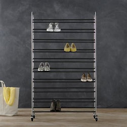 Supreme Adjustable Rolling Shoe Rack - For the closet of your dreams, we recommend this large-capacity rolling rack that customizes to your shoe size. Smart styling with height-adjustable shelves frees floor space, organizing up to 50 pairs of shoes within easy reach and stabilizing them with nonslip grips. Optional wheels (two locking) offer the choice of rolling or stationary storage.