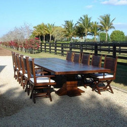 Idlewild Furnishing - This extra ordinary old wood Teak dining table is for indoor or outdoor use. We make this dining table in all sizes. plank top, 14ft x 5ft.
