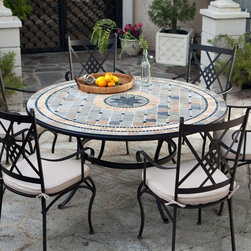 Belham Living - Belham Living Barcelona 60-in. Round Mosaic Patio Dining Set - Seats 6 Multicolo - Shop for Tables and Chairs Sets from Hayneedle.com! Additional features: Dining chairs: 19L x 22.5W x 40.25H inches (ea)Dining chair weight: 15 lbs. (ea)Dining table: 60 diam. inchesDining table weight: 120 lbs.Comfortable spacious chair seat and supportive diamond motif backTraditional Italian design for the modern homeEasy maintenance - wipes clean with mild dish soap and waterWater- and UV-resistant foam seat cushions wrapped in DacronUmbrella hole for a standard 1.5-inch diameter umbrella poleTable top plug for use without an umbrellaEasy to assembleSeats 6 peopleAvailable exclusively on Hayneedle.com If you want to make dinnertime fun again you won't go wrong with the Palazetto Barcelona 60 in. Round Mosaic Patio Dining Set. A great way to bring family and friends together this wrought iron dining set adds an upscale look to any outdoor setting with its classic Italian design and timeless appeal. And the best part is that since this dining set which includes a 60-inch dining table and six chairs is exclusive only to Hayneedle.com you get all the compliments at almost half the price you'd be paying for a similar item in a retail store. Hand-laid mosaic tiles combine with hand-forged wrought iron to make a look that's decidedly eye-catching. Jewel-toned shades of blue and green are accented with beige and brown earth tones to bring a warm welcoming feel to your outdoor dining area. And because these tiles are hand-set each Barcelona table is truly one of a kind! Next the top is finished and sealed with an industrial-grade sealant called Fluorocarbon for superior protection. This means if the table top get wets the grout won't dry out and crack like traditional standard grout would. Wear and tear of elements over time may lead to blistering of the silicone top seal and natural aging of the tile materials giving the table an aged look. Built to last the hand-forged wrought iron table base and chair frames are dipped in a zinc-phosphate bath and then E-coated to help make a weather-resistant coating to delay the onset of rust. All wrought iron pieces are quality-checked for strength and durability while iron welds are ground for aesthetic appeal. Finally a powder-coated dark bronze finish is applied and baked onto the iron for stronger color and protection. Not to be outdone in the comfort department the chairs are generously proportioned and feature supportive diamond-motif backs gracefully curved legs and scrolled armrests. Beige seat cushions with chair ties will envelop you in luxurious comfort inviting you to linger at the table way longer than usual. The seat cushions are foam-wrapped in Dacron. Inner cover is a white polyester bag and outer fabric cover is a polyester-cotton mix which is water- and UV-resistant. You'll also love the fact that the dining table has an umbrella hole so you can pair it with a standard patio umbrella (1.5-inch-diameter pole) on particularly hot days. It also comes with a plug for the table top for when an umbrella is not being used. About PalazettoBlending the lines between interior and exterior decor Palazetto furnishings are designed to bring the indoors out. Palazetto believes alfresco living should be enjoyed by all and they center this belief on beautiful cast aluminum and wrought iron pieces and stunning outdoor mosaics designed to warm your patio and soothe your senses. The Palazetto collection is available at almost half the price you'd pay for something similar in a retail store so you may be surprised to learn that all mosaic table tiles are hand-set. They're then grouted with industrial adhesives for maximum durability and sealed with an industrial-grade sealant called Fluorocarbon for superior protection. And quality mosaic table tops aren't the only thing they can boast about. Each piece in the Palazetto aluminum and wrought iron collections feature the highest quality construction from rust-proof materials to fully welded joints to weather-resistant powder-coat finishes. You'll be enjoying these sets for years as they can withstand extended outdoor exposure in any climate in any season. So gather up your family and head to the backyard for some quality time around quality furniture. With Palazetto you'll quickly find you're as comfortable here as you were inside.
