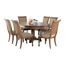 American Drew - American Drew Grand Isle 7-Piece Round Dining Room Set in Amber - The Grand Isle collection is a lifestyle bedroom and dining room group that offers high end, yet casual up to date tropical style with multiple options for any room of the home; creating a collection that is perfect for many homes, vacation homes or even smaller size vacation condos. The amber finish has a warm overtone with subtle dark burnished accents that make the natural soft distressing show through. Design elements used in Grand Isle include carved and shaped pilasters, woven drawer fronts and a louver motif; all adding a higher end look to the collection. This collection is sure to add a relaxed, yet sophisticated style to most homes and offers plenty of options to help with storage and organization.