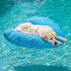 Frontgate - Dog Pool Float and Lounger Dog Bed - Vinyl-coated fabric and nonporous foam make this lounger ultra-buoyant and strong. Crafted of puncture-resistant, woven vinyl mesh that won't stain, fade, or mildew. Dampened, it will keep your pet cool and relaxed. With our Dog Pool Float and Lounger, Fido can float in style—or stay cool as he lounges on deck. . Crafted of puncture-resistant, woven vinyl mesh that won't stain, fade, or mildew. .