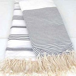 Hammam Towel - I love when my purchases can serve multiple functions. What's great about these traditional Turkish bath towels is that they look just as beautiful hanging in your bathroom as they will on your dining room table. Finally, a towel that I will be proud to lounge on in public.