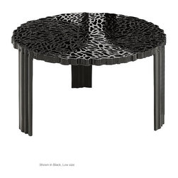 T-Table by Kartell - I first discovered the work of designer Patricia Urquiola via the Random Light, and I've been fascinated with the unique ways she experiments with textures and materials ever since. A perfect example is this table, which has an intricate pattern that looked like it could have been natted like a lace doily, yet it's made out of PMMA. Genius.