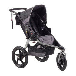 B.O.B. Revolution SE Stroller - Black - Essentially two strollers in one the B.O.B. Revolution SE Stroller - Black helps the modern-day parent keep up with the fast flow of the times. Its durable and lightweight frame easy two-step folding and large storage compartments make this a perfect stroller for running errands around town with the swivel lock off allowing for greater maneuverability. Then by turning the swivel lock on you can increase the stability and speed of the Revolution SE to use it as a jogging stroller enabling you to briefly get away from the various demands on your time and to recharge yourself mentally and physically. All the while the revolutionary design of this stroller ensures that the fast pace of your environment (whether moving from one task to the next or simply racing down a trail) won't faze your child as they tag along for the ride. The innovative shock absorption system adjustable canopy padded harness and open cell foam padded seats will guarantee your little one stays snug and secure wherever you lead them and no matter how long it takes. When life places such a broad array of expectations before you it's nice having one piece of equipment that can meet them all. Additional features: Front wheel swiveling capability for tighter turns Front wheel locking mechanism for active performance State-of-the-art adjustable suspension system Easy two-step folding Padded handlebar and wrist strap for sure grip Ultra-padded adjustable reclining seat Adjustable canopy with viewing window High-impact polymer composite wheels are extra tough 1 Low Boy Cargo Basket 1 large seatback pocket Internal seat pockets Tracking knob to keep stroller rolling straight Design specifications: Weight: 25lbs. Capacity: 70lbs. (occupant plus luggage weight) Padded 5-point harness Frame material: high-strength aluminum alloy Seat material: water-repellant coated weave fabric Open cell foam padding Coil spring and elastomer core suspension system Adjustable shock release for varying weight capacity Rear pneumatic tires: 1.75W x 16H inches Front pneumatic tires: 1.75W x 12.5H inches Pneumatic tubes with schrader valve Hub: quick release axle Sealed cartridge ball bearings High-impact polymer composite wheels and spokes Foot-activated rear wheels parking break Canopy: 5 position toggle 125-degree range About B.O.B.In 1994 Roger Malinowski a bicycle industry maven met Philip Novotny an airline mechanic in San Luis Obispo California. From the marriage of Novotny's ingenuity and Malinowski's industry knowhow came B.O.B. a world-renowned company with roots in developing revolutionary bicycle trailers such as the YAK. Once Malinowski and Novotny began raising families they felt an urge to start applying the innovative principles they developed in bicycle trailers to strollers. They strived to build a superior product that would combine the best of a bunch of worlds: a lightweight high-quality stroller that you could take running hiking and off-roading and that would still fold up easily and compactly. Like any sensible entrepreneurial parent Malinowski and Novotny subjected their designs to rigorous analysis . . . by testing them on their own children. The result was their wildly successful Sport Utility Stroller. Then through an endorsement by the famous Ironman triathlon endurance race as well as the addition of several more groundbreaking innovations such as a swiveling front wheel B.O.B. has become one of the most visible trusted names among athletic parents.