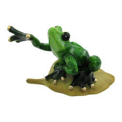 Zeckos - Spotted Green Tree Frog on Leaf Statue Figure Life-Like - This wonderful table figurine features a speckled green tree frog on a leaf reaching a front leg out to take his next step. The figurine measures 3 inches tall, 5 1/4 inches long and 2 3/4 inches wide. He has glossy black feet and eyes, and metallic gold accents on his toes. The tree branch and rocks underneath are very life-like. He makes a great gift for frog fans.