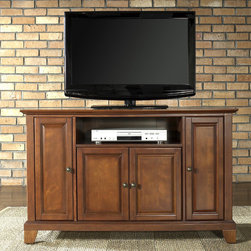 """Crosley - Newport 48"""" TV Stand - Enhance your living space with one of Crosley's impeccably-crafted TV stands. This signature cabinet accommodates most 52'' flat panel TVs and is handsomely proportioned featuring character-rich details sure to impress. Raised panel doors strategically conceal stacks of CDs/DVDs, gaming components and various media paraphernalia. Open storage area generously houses media players and the like. Adjustable shelving offers an abundance of versatility to effortlessly organize by design, while cord management systems tame the unsightly mess of tangled wires. Customize our distinct cabinets by selecting one of four collection styles (featuring tapered, traditional. turned or bun feet) in your choice of one of three signature Crosley finishes. This customizable cabinet approach is designed for easy assembly, built to ship and constructed to last. Features: -Raised panel doors.-Five adjustable shelves for storing electronic components, gaming consoles, DVDs and other items.-Adjustable levelers in legs.-Recommended TV Type: Flat screen.-TV Size Accommodated: 48"""".-Powder Coated Finish: No.-Gloss Finish: No.-Material: Hardwood and veneers.-Solid Wood Construction: No.-Distressed: No.-Exterior Shelves: Yes -Number of Exterior Shelves: 1.-Adjustable Exterior Shelves: No..-Drawers: No .-Cabinets: Yes -Number of Cabinets: 3.-Number of Doors: 4.-Door Attachment Detail: Pin hinge.-Interchangeable Panels: No.-Magnetic Door Catches: Yes.-Cabinet Handle Design: Knob.-Number of Interior Shelves: 5.-Adjustable Interior Shelves: Yes..-Scratch Resistant : No.-Removable Back Panel: No.-Hardware Finish (Finish: Black): Brushed nickel knobs, steel hardware.-Hardware Finish (Finish: Classic Cherry, Vintage Mahogany): Antique brass knobs, steel hardware.-Casters: No .-Accommodates Fireplace: No.-Fireplace Included: No .-Lighted: No .-Media Player Storage: Yes.-Media Storage: No .-Cable Management: Hole in back for wires.-Remote Control Included: No.-Batteries Req"""