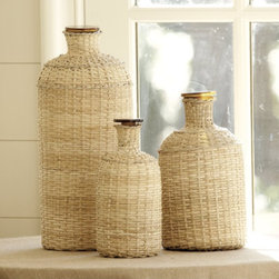 Covered Demijohn - Created by master craftsmen and made of heavy mouth-blown glass, you'll love the look of these demijohn bottles covered in woven cane, jute and burlap.  They are a great way to add texture and interest to a tabletop, shelf or kitchen counter.