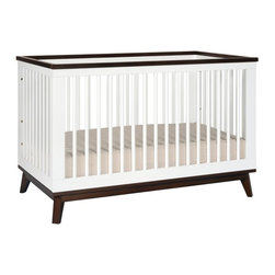 Babyletto - Babyletto Scoot 3-in-1 Convertible Crib - M5801WL - Shop for Cribs from Hayneedle.com! Beautiful and retro the Babyletto Scoot 3-in-1 Convertible Crib adds a modern twist to this mid-century style crib. Designed to grow with your child this crib easily converts from a crib to a toddler bed (conversion kit included) and a daybed (conversion kit not included). Made from gorgeous and sustainable New Zealand Pine wood this crib comes in your choice of beautiful non-toxic finishes which are lead and phthalate safe. Four adjustable mattress levels allows you to lower the mattress as your baby grows for added safety. JPMA certified and meeting ASTM international and US CPSC safety standards this gorgeous crib coordinates with other items from the Babyletto Scoot collection. Additional Features Slat strength: 135 lb. 4 adjustable mattress levels. Includes toddler conversion kit JPMA certified Meets ASTM and CPSC standards About BabylettoModern and stylish while remaining affordable and eco-friendly Babyletto is a brand with a vision. Established in 2010 Babyletto takes pride in offering quality products for families all designed to open the heart and spark imagination. Working from a platform based on fond childhood memories and special moments they strive to infuse every design with an essence of honesty and creativity while crafting each piece with impeccable quality. Safety is at the forefront of each and every thing they produce and a long-standing relationship with their producers helps to maintain this commitment as well as their dedication to eco-friendly manufacturing.