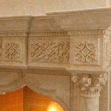 Mediterranean Indoor Fireplaces by AVID Associates LLC