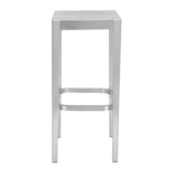 """Emeco - Barstool - Design Features: -Hand-crafted using signature 77-step process -Built on the vision of sculptured masterworks: one piece construction without connections -Soft aluminum provides smooth bends without distortion and total comfort -Proprietary thermal treatment makes lightweight products three times stronger than steel -Hand-brushed finish improves with age and resists rust -Non-absorbing and sanitary: resists bacteria, mildew, stains and odor -Eco-friendly: uses recycled materials and is itself recyclable -Non-flammable: meets or exceeds all applicable fire codes Product Features: -Can be used indoors or outdoors -Suitable for institutional or home use -Stays cool to the touch even in the hot sun -Maintenance-free -Lasts a lifetime -Available in several finishes -Optional black vinyl seat pad for added comfort -Made in the USA Dimensions: -30""""H x 14""""W x 14""""D Order with Confidence: -Emeco puts environmental safety at the forefront of design. Between 75% and 80% of the aluminum used in Emeco products is recycled and the estimated lifespan of most Emeco chairs is 150 years or more. -The Emeco Stools Collection is backed by a lifetime warranty. These chairs, stools and tables are warranted to be free from defects in materials and workmanship under normal use and conditions. -Should you discover shortly after receiving your Emeco product that parts are either damaged or missing, please call us immediately, and we will be happy to send you replacement parts as soon as possible and at no additional cost. Please Note: -Hand polished finish ships in 8 weeks -All other finish options ship in 4-6 weeks"""