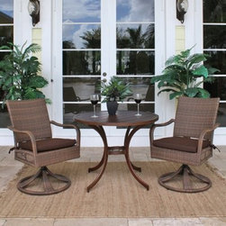 "Hospitality Rattan Grenada 3 Piece Swivel Rocking Dining Bistro Set - Viro Fiber - Poolside, on the patio, out front, in the garden - the Hospitality Rattan Grenada 3 Piece Swivel Rocking Dining Bistro Set - Viro Fiber Antique Brown goes anywhere. The Grenada Collection has a modern, tropical feel that offers a clean look for any patio area - not to mention the convenience of all-weather wicker. This set's two rocking chairs are each supported by a sturdy swiveling base and an aluminum frame wrapped in high quality antique brown Viro fiber. High backs offer supreme comfort and decorative open weaving along the sides of each seat is light and airy. The dark bronze aluminum table boasts dramatically curved legs, an artful center support, and an easy-clean slatted top.DimensionsChairs: 24L x 29W x 36H inchesTable: 36 diam. x 29H inchesAbout Hospitality Rattan Hospitality Rattan has been a leading manufacturer and distributor of contract quality rattan, wicker, and bamboo furnishings since 2000. The company's product lines have become dominant in the Casual Rattan, Wicker, and Outdoor Markets because of their quality construction, variety, and attractive design. Designed for buyers who appreciate upscale furniture with a tropical feel, Hospitality Rattan offers a range of indoor and outdoor collections featuring all-aluminum frames woven with Viro or Rehau synthetic wicker fiber that will not fade or crack when subjected to the elements. Hospitality Rattan furniture is manufactured to hospitality specifications and quality standards, which exceed the standards for residential use. Hospitality Rattan's Environmental Commitment Hospitality Rattan is continually looking for ways to limit their impact on the environment and is always trying to use the most environmentally friendly manufacturing techniques and materials possible. The company manufactures the highest quality furniture following sound and responsible environmental policies, with minimal impact on natural resources. Hospitality Rattan is also committed to achieving environmental best practices throughout its activity whenever this is practical and takes responsibility for the development and implementation of environmental best practices throughout all operations. Hospitality Rattan maintains a policy of continuous environmental improvement and therefore is a continuing work in progress. Hospitality Rattan's Environmentally Friendly Manufacturing Process All of Hospitality Rattan products are green. From its basic raw materials of rattan poles, peels, leather, bamboo, abaca, lampacanay, wood, leather strips, and boards, down to other materials like nails, staples, water-based adhesives, finishes, stains, glazes and packing materials, all have minimum impact to the environment and are safe, biodegradable, recycled, and mostly recyclable. Aside from this, the products have undergone an environmentally-friendly process that makes them """"greener."""" The company's rattan components are sourced from sustained-yield managed forests, which means the methods used to grow and harvest the rattan vines ensure the long-term life of the forest and protect the biodiversity of the forest's ecosystems. Hospitality Rattan is committed to buying and using all materials, from rattan and hardwood to finishing materials, from reputable and renewable suppliers and seeks appropriate evidence that suppliers are in compliance with this policy. Hospitality Rattan strives to use materials that are processed in an environmentally responsible manner, or consist of a high level of recycled material. Finishing materials and stains used in Hospitality Rattan's furniture products consist of 75% water-based solutions which evaporate upon application with reduced or Volatile Organic Compounds (VOCs). The furniture factories use water-based glues, stains, topcoats and other finishes on all of their products. The switch from traditional solvent-based processes to water-based processes involved consolidating several processes by the factories, resulting in an 85% reduction in VOC emissions."