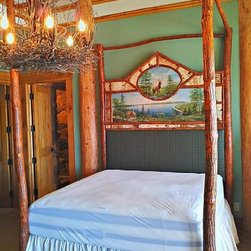Rustic Sassafras and Birch Canopy Log Bed with Custom Painting - We were commissioned to build this one of a kind king size sassafras canopy log bed with a very special painting on canvas. Masterfully rendered and framed in by birch bark and sassafras trim. Wool upholstered head rest. We can help you design your dream bed too.  Contact us for any of your rustic furniture needs. We build just about everything. Email us at info@woodzy.org Photos by  Robert R. Norman.