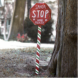 Stop Sign for Santa - New - How else will Santa know where to drop off the presents? This adorable handpainted sign is a great way to reassure the kids that Santa will indeed be stopping by, and its brightly striped base looks great in a yard or even propped up in a corner inside.