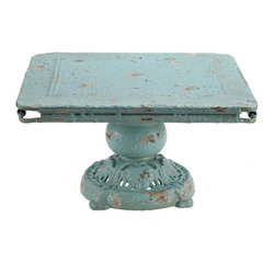 Raise Me Up Pedestal - This metal pedestal will give your favorite items the attention it deserves. The distressed blue color of our Raise Me Up Pedestal enhances any piece you choose to display. Because of its size, it can easily fit on any counter space and can be used to hold a tray, fruit bowl, or small appliance.