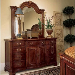 American Drew - Cherry Grove Door Dresser - ADL972 - Shop for Dressers from Hayneedle.com! Traditional styling of the 18th century finds expression in the beautiful Cherry Grove Door Dresser. Designed to complement your lifestyle this charming dresser draws attention with its exquisite craftsmanship and superior quality.Crafted from cherry veneers alder solids and select hardwoods this gorgeous dresser looks resplendent in an Antique Cherry finish. Elegant lines and form and bring out its old world charm and unique character creating a warm and inviting ambiance.The two-door dresser has nine spacious drawers that offer additional storage for your everyday items. An adjustable shelf behind the doors makes storage even more convenient. The insides of the drawers are sprayed with a light finish and have cherry wood at the bottom. They feature English dovetail construction both at the back and in front for hassle-free long-lasting use.The Cherry Grove Dresser features decorative drawer pulls which are protected with a clear lacquer coat to keep them looking like new even years down the line. The optional beveled mirror is beautifully designed and adds to the rich luxurious look of the dresser.