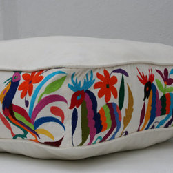 Butterfly and Deer Otomi Pouf by Casa Otomi - If a large wall hanging is too much commitment, inject a little Otomi pattern in an unexpected spot — like on the side panel of this pouf.