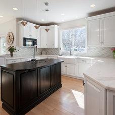Transitional Kitchen by Swerdloff Properties Inc.