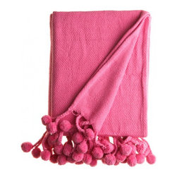Pom Pom Blanket, Pink - Who says you always have to shop from kids' stores for nursery items? This hot pink pom-pom–trimmed throw from Calypso St. Barth caught my eye recently, and I think it would be gorgeous tossed over the arm of a rocker in a little girl's nursery.