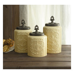"Jay Companies - Antique Fleur De Lis Cream Canister Set - Treat yourself with our high quality Antique Cream Colored Canister Set. Perfectly carved of fine ceramic, and intricately designed with a spectacular fleur de lis symbol, each canister boasts a fine metal lid and neat finial, making this set an all time favorite! Complete your French Country or Old World decorating theme with these vintage and wonderfully unique ceramic canisters.          * Set of 3 * Measures: Large: 11.8""H, Medium: 10.4""H, Small: 9.3""H * Care: Hand wash   * Includes rubber gasket on top to insure freshness"