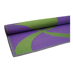 KOKO - Waves Print Floor Mat, Green and Purple - These waves feel modern and fresh. You could stash a few of these in the car for impromptu beach trips. They're stylish and easy to clean since you can simply hose them off at the end of the day.