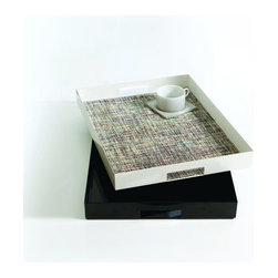 Chilewich - Manhattan Tray One by Chilewich - Rethink the way you serve--every time you serve--with the Chilewich Manhattan Tray One. While lovely all on its own, this powder-coated iron tray is designed to be lined with any of Chilewich's rectangular tablemats. With more than 100 colors and patterns of tablemats available, the tray can be personalized to suit any mood or occasion. Part of the Manhattan Tray Project series. Tablemats sold separately. For over a decade, New York based designer Sandy Chilewich has been creating original and innovative vinyl products for the home. Her woven, tufted, molded and spun textiles are available in a range of vibrant and neutral hues that have become synonymous with the Chilewich brand name.