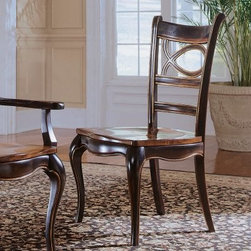 Hooker Furniture Preston Ridge Oval Back Dining Side Chairs - Set of 2 - They may be side chairs, but the classic style of the Preston Ridge Oval Back Dining Side Chairs - Set of 2 refuses to be sidelined. Classically shaped legs, an open oval back, comfortable arms, and the most stunning black and cherry rub-through finish. The contrasting wood seat gives that little extra detail, and the airy styling keeps it light and sophisticated.Not available for sale in, or delivery to, the state of California.About Hooker Furniture CorporationFor 83 years, Hooker Furniture Corporation has produced high-quality, innovative home furnishings that seamlessly combine function and elegance. Today, Hooker is one of the nation's premier manufacturers and importers of furniture and seeks to enrich the lives of customers with beautiful, trouble-free home furnishings. The Martinsville, Virginia, based company specializes in lifestyle driven furnishings like entertainment centers, home office furniture, accent tables, and chairs.Construction of Hooker FurnitureHooker Furniture chooses solid woods and select wood veneers over wood frames to construct their high-quality pieces. By using wood veneer, pieces can be given a decorative look that can't be achieved with the use of solid wood alone. The veneers add beautiful accents of color and design to the pieces, and are placed over engineered wood product for strength. All Hooker wood veneers are made from renewable resources and are located primarily on the flat surfaces of the furniture, such as the case tops and sides.Each Hooker furniture piece is finished using up to 30 different steps, including 13 steps of hand-sanding and accenting. Physical distressing is done by hand. Pieces receive two to three coats of solid lacquer to create extra depth and add durability to the finish. Each case frame is assembled using strong mortise-and-tenon joints, which are then reinforced by mechanical fasteners and glue. On most designs, end panels extend to the floor to add strength and stability. Panel-style furniture features strong panel and frame construction to help avoid warping.Your Hooker furniture features finished case interiors to eliminate unsightly raw wood and to help protect items you may store inside drawers or cabinets. Drawer parts are given a urethane or lacquer finish to create smooth action and durability. All drawers use dovetails, either English or French, for years of problem-free use. Drawer bottoms are constructed from plywood and attached to the plywood drawer sides via the use of hot glue and/or wood glue blocks. Most drawers are full width, depth, and height to provide the maximum amount of storage space.