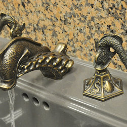 Home Hardware Oriental Dolphin Or Sea Dragon Sink Faucet Set - An impressive sea dragon creature is featured for the spout, detailed smaller sea dragons are used for the handles, and the drain pull has an additional sea dragon. The base of the sink handle has six different sea creatures cast into it, including a crab, a seahorse, a turtle, a sea dragon, a flying fish, and a scallop shell.