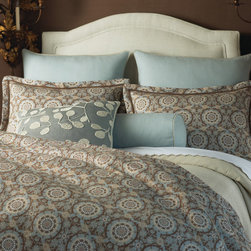 Peacock Alley Olympia Duvet Cover | Gracious Style - Textured linen makes the perfect canvas for this distinctive medallion print in shades of misty blue, taupe and flax. Olympia's washable duvets and shams offer touchable texture. The duvets are made with the softest of sateen sheeting on the reverse. Reverses to Soprano Taupe Sheeting. 100% linen made in the USA from imported fabric. By Peacock Alley.