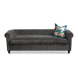 "Grandin Road - Harrison Sofa in Gray - Cut velvet sofa with a low profile. One long seat cushion, instead of multiple cushions. Down-stuffed cushion will soften over time. Rolled arms are the same height as the back. Fabric is 100% polyester. Free Swatches Available. Make a sophisticated statement, while also making yourself incredibly comfortable, with the David Bromstad Harrison Sofa. It's an exquisitely chic settee with a low-profile silhouette, and commands a striking presence. Upholstered in luxurious cut velvet with one long seat cushion, which is overstuffed with down feathers that will soften over time.  .  .  .  . . Glossy black turned feet . Durable maple frame. Sinuous ""no sag"" springs and rubber webbing. . Each sofa is made by hand. A Grandin Road exclusive."