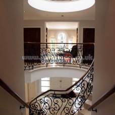 Contemporary Staircase by Winstaco - Stairs Windows Company