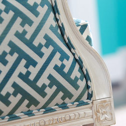 Meet The New Eclecticism - Mix and mismatch. Upholster a classic French chair in a modern fretwork fabric.