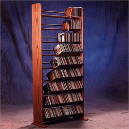 """Wood Shed - Deluxe 504 CD Multimedia Storage Rack - This rack is made with high attention to detail and quality. This product looks great as it is solid wood and does not have any screws. Features: -Holds 504 CD's.-Commercial Use: Yes.-Material: Solid oak.-Solid Wood Construction: Yes.-Number of Items Included: 5 items: 1 rack, 2 feet & 2 sliders.-Scratch Resistant: Yes.-Heat Resistant: No.-Stain Resistant: Yes.-Drawers Included: No.-Exterior Shelves Included: Yes -Adjustable Exterior Shelves: No..-Cabinets Included: No.-Distressed: No.-Collection: Deluxe.-Recycled Content: No.-Eco-Friendly: No.-Storage Capacity: 504 CD's.-Country of Manufacture: United States.-Wall Mountable: No.Specifications: -ISTA 3A Certified: No.Dimensions: -Overall Height - Top to Bottom: 61.5"""".-Overall Width - Side to Side: 24.25"""".-Overall Depth - Front to Back: 7.25"""".-Drawer: No.-Shelving: -Shelf Height - Top to Bottom: 6"""".-Shelf Width - Side to Side: 23.5"""".-Shelf Depth - Front to Back: 6""""..-Overall Product Weight: 31 lbs.Assembly: -Assembly Required: No.Warranty: -Product Warranty: 6 months."""