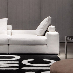 Minotti - Minotti Jagger Low Back Sofa - Minotti relies on Jagger to answer the need for softness and casualness.  Softness taking different shapes, something that makes you sense a whole world.  Jagger is available in a variety of shapes.  This particular version has a low back.  Comfort is made a possibility with goose down cushions (the backrests are made entirely from goose down).  The feet of the sofa are metal with a bright chrome-plated finish.  This sofa is available in three sizes with the option of two, three, or four back cushions.  Price includes shipping to the USA.  Manufactured by Minotti.