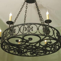 Electric Arizona Iron Lamp - This chandelier makes a serious statement. It would look terrific in a dining room with high ceilings or spice up your porch and place it outdoors. Either way, it's a win.