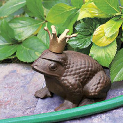 Frog Prince Statue - I'm not a fan of garden gnome statues, but I love my frog prince. My frog sits proudly in our front flower bed. He serves an important purpose: He protects my plants from the garden hose!