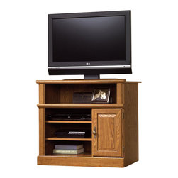 Sauder - Sauder Orchard Hills Small Highboy TV Stand in Carolina Oak Finish - Sauder - TV Stands - 401342 -Sauder Orchard Hills collection TV stand is constructed of medium density fiberboard with a durable Carolina Oak laminate finish. TV stand features a doored storage area that holds 25 CDs, 19 DVDs, or 10 VHS tapes. Component storage area has two adjustable shelves. TV shelf weight limit is 135 lbs. Ships ready to assemble.