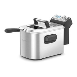Frontgate - Breville Smart Fryer - Brushed stainless steel frying basket and cooking bowl. 110-120 volts. 1800-watts. Electronic thermostat allows oil to rapidly recover back to desired frying temp. Mesh filter minimizes cooking odors. Fry everything from French fries to calamari with Breville's the Smart Fryer. Simply select what you are cooking and this smart appliance will deliver the right temperature at just the right time. It also includes a twice-fried function for restaurant quality French fries and makes adjustments for fresh or frozen ingredients.  .  .  .  .  . Illuminated easy read LCD automatically indicates time, temperature, plus pre-programmed cooking functions . 4-quart oil vessel; 2-1/2 lb. frying basket capacity . Large viewing window . Fresh and frozen menu options . Magnetic removable power cord . Automatic shut-off protection . Non-skid feet .