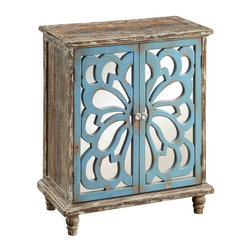Coast To Coast Imports - Distressed Two Door Cabinet - This two-door cabinet combines a rustic and aged base with a sophisticated cutout design over a bright mirror, creating depth and interest. The Devale Brown finish has a lovely distressed patina and trim. The intricate Blue cutout design is a beautiful organic shape that is nature-inspired. An interior shelf allows more storage and the decorative knobs add sparkle.. 13 in. D x 26 in. W x 31.25 in. H (31.9 lbs )