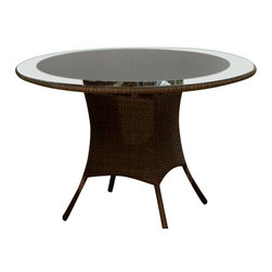 """Hospitality Rattan - Grenada Patio Round Dining Table in Antique F - Your outdoor dining space will be elegant and sophisticated with a hint of island inspiration with this sophisticated table, a round woven wicker table with a durable aluminum frame. A frosted glass top adds visual interest to the contemporary outdoor piece. This product is warranted for outdoor use. Made of Aluminum Frame w All Weather Viro Fiber Wicker. Constructed of an aluminum frame wrapped in woven viro fiber. Viro Fiber antique finish. Includes tempered frosted glass with umbrella hole. Weather and UV resistant. Matching seating group and bar stool available. Some assembly required. 50 in. W x 50 in. D x 30 in. H (100 lbs.)The Grenada contemporary patio set has a fully anodized aluminum frame and woven Viro fiber, which gives this collection a unique textured surface. The Grenada Collection does not require cushions. The collection also features frosted tempered glass on all its tables, along with the ability to accommodate an umbrella with the patio dining set. Cushions are optional and are not included.The Grenada Collection has a contemporary, yet tropical feel that offer a clean look for any patio area and the convenience of all-weather wicker. Supported by an aluminum frame wrapped in high quality Viro fiber. This all-weather wicker 48"""" dining table is woven along the lower area and along the outside of the top, and the glass is frosted towards the center. This table also accommodates an umbrella. The simplicity of the Grenada collection and the versatility really make it an excellent choice for anyone. These chairs are stackable for easy storage. They are also contract quality."""