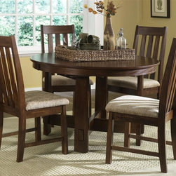 Liberty Furniture - Urban Mission 5 Pc Dining Set - Includes table and four side chairs. One 18 in. butterfly leaf. Comfortably seats upto 4. Nylon chair glides. Generously padded upholstered seats. Warranty: One year. Made from select hardwoods and oak veneers. Dark mission oak finish. Made in Malaysia. Side chair: 21 in. W x 18 in. D x 42 in. H (23 lbs.). Table minimum: 48 in. L x 48 in. W x 30 in. H. Table minimum: 66 in. L x 48 in. W x 30 in. H (108 lbs.)